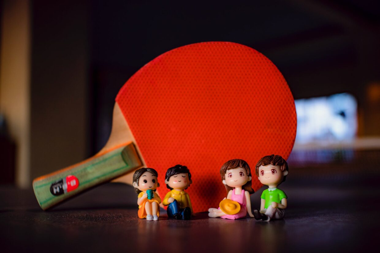 figurines near ping pong racket
